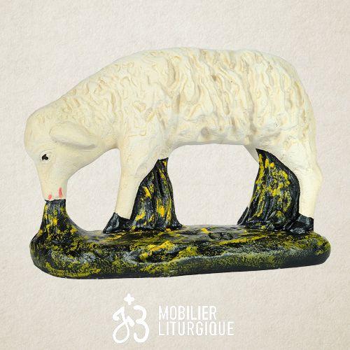 Animal de la crèche : Mouton broutant, en plâtre coloré