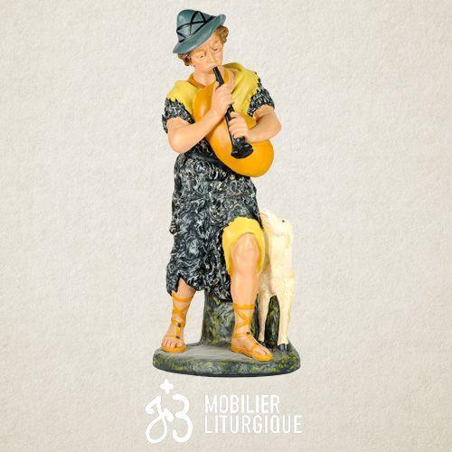 Personnage de crèche : Berger jouant de la cornemuse, en plâtre coloré
