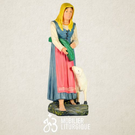 Personnage de crèche : Bergère avec son mouton, en plâtre coloré