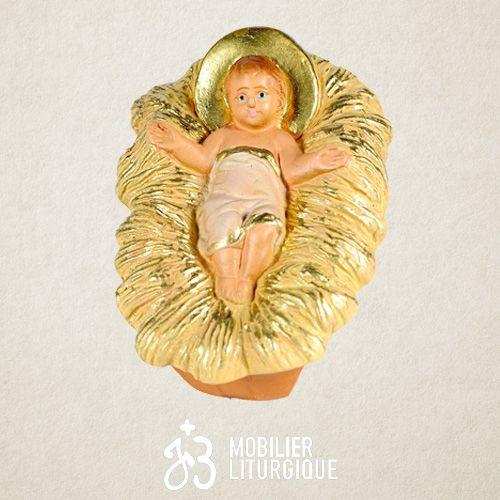 Personnage de crèche : Enfant Jésus dans son berceau, en plâtre coloré